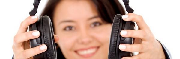 girl holding headphones